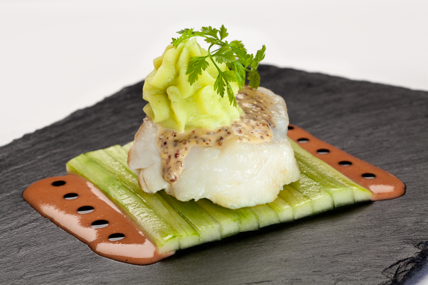 Haute Cuisine - sea bass sitting on top of shaved slices of cucumbers is styled to perfection!