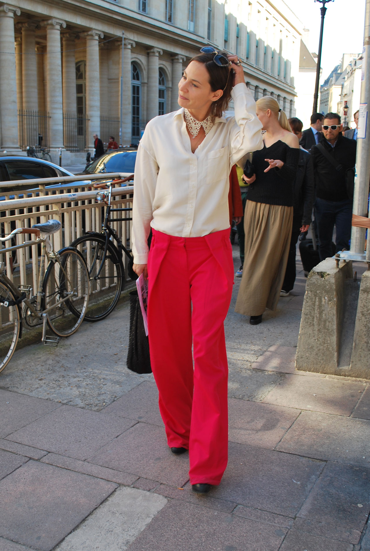 Solid red trousers paired with neutrals